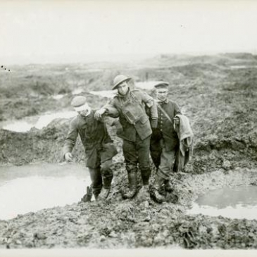 Canadian and German wounded help one another through the mud during the capture of Passchendaele (CO3758) © Canadian War Museum